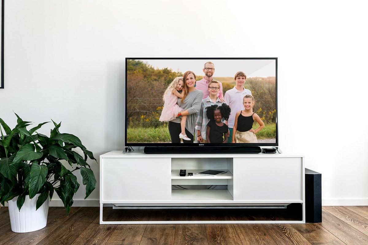 vise bilder fra telefon på tv